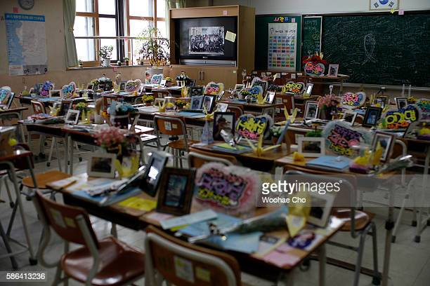 Flowers and notes from colleagues paying tribute to the victims of the Sewol ferry are on the desks in a second year classroom at Danwon High School...