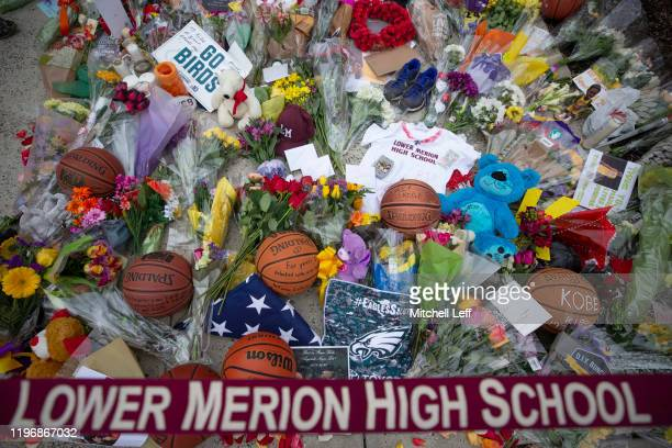 Flowers and other items are left at a memorial for former Los Angeles Laker Kobe Bryant after he was killed in a helicopter crash at Lower Merion...