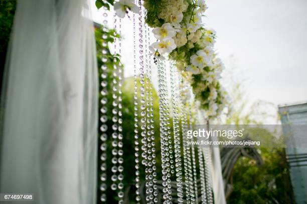 flowers and pearl on wooden archway for wedding - www images com stock photos and pictures