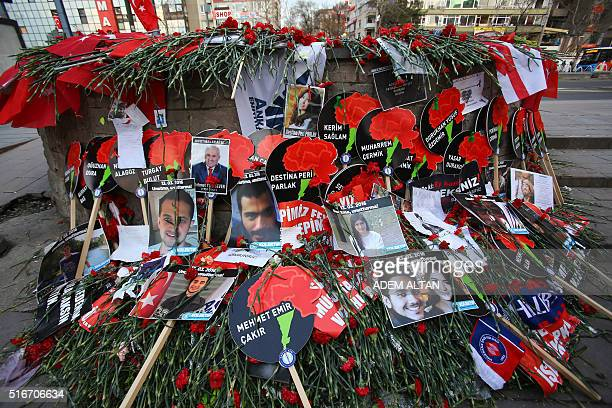 Flowers and photos are displayed in remembrance of the victims of the attack on March 20 2016 in Ankara on the site of the blast that killed 35...