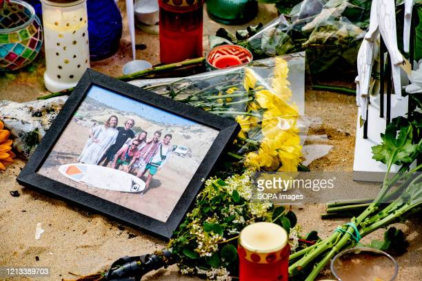 Flowers and pictures of the laid at the monument during the tribute to the deceased five surfers who were lost at sea at Shore Scheveningen as people...