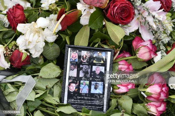 Flowers and pictures of the nine victims are seen at the market square in Hanau near Frankfurt western Germany on March 4 prior to a memorial service...