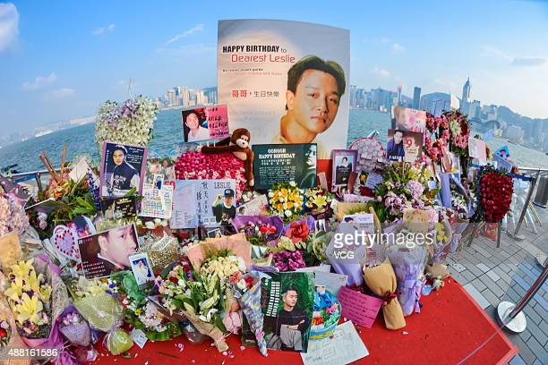 Flowers and posters are presented to mourn singer and actor Leslie Cheung at Avenue of Stars on September 13 2015 in Hong Kong Cheung died aged 46...