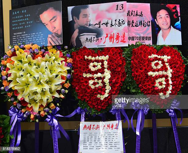 Flowers and posters are presented to mourn singer and actor Leslie Cheung the day before the 13th anniversary of his death at Hong Kong Mandarin...