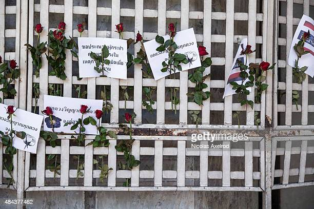 Flowers and signs are put up near the site of the bomb expolsion on August 18 2015 in Bangkok Thailand Last night a bomb explosion in the centre of...