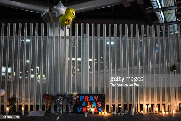 Flowers and signs are seen at a vigil that was held for the victims along the Las Vegas Strip a day after 59 people were killed and more than 500...