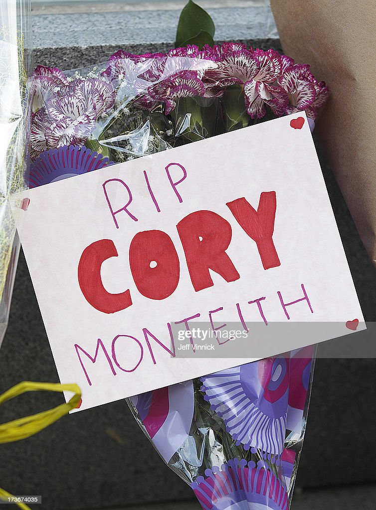 Flowers and signs left by mourning fans occupy a memorial to deceased actor Cory Monteith outside the Fairmont Pacific Rim Hotel on July 16, 2013 in Vancouver, British Columbia, Canada. The B.C. Coroners Service released results of Monteith's autopsy today and found the 31-year-old's cause of death was a mixed drug toxicity involving heroin and alcohol.