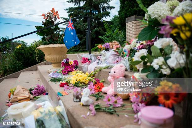 Flowers and signs memorialising Justine Damond are placed on the stairs of the Lake Harriet Spiritual Community centre on July 18 2017 in Minneapolis...