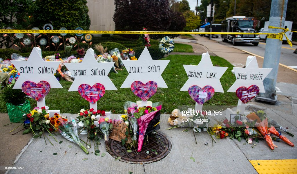 Flowers and stones are placed on the memorials erected... : News Photo