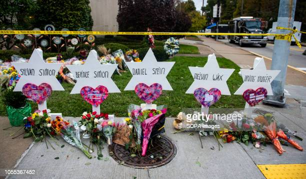 Flowers and stones are placed on the memorials erected outside of the Tree of Life Synagogue in Squirrel Hill Members of Pittsburgh and the Squirrel...