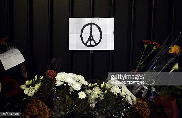 Flowers and the '#PeaceForParis' logo are seen outside the French Embassy in Greece on November 14 a day after deadly attacks in Paris Islamic State...