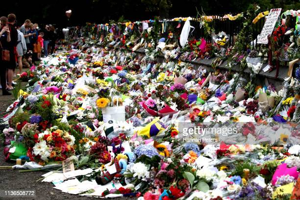 Flowers and tributes are laid at the Botanic Gardens on March 18 2019 in Christchurch New Zealand 50 people are confirmed dead with with 36 injured...