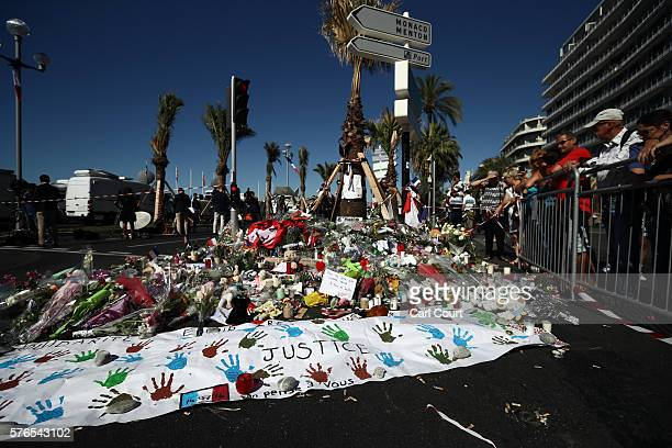 Flowers and tributes are laid on the Promenade des Anglais on July 16 2016 in Nice France Five people believed to be linked to the man who killed 84...