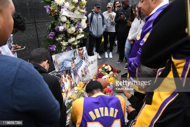 Flowers and tributes are left at a makeshift memorial for former NBA player Kobe Bryant outside the 62nd Annual GRAMMY Awards at STAPLES Center on...