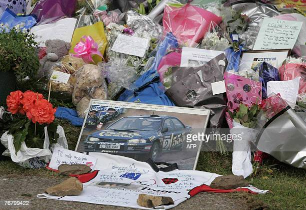 Flowers and tributes are left outside the home of former rally world champion Colin McRae in Lanark in Scotland 17 September 2007 Air accident...