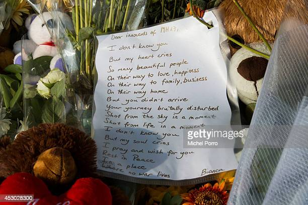 Flowers and tributes are left to commemorate the victims of Malaysian Airlines flight MH17 at Schiphol Amsterdam Airport on August 1 2014 in...