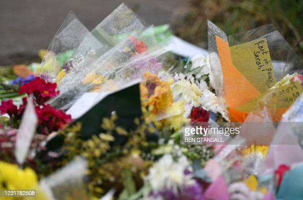 Flowers and tributes are pictured at the entrance to Great Chart Golf and Leisure near Ashford, southeast England on March 18 near to where the body...