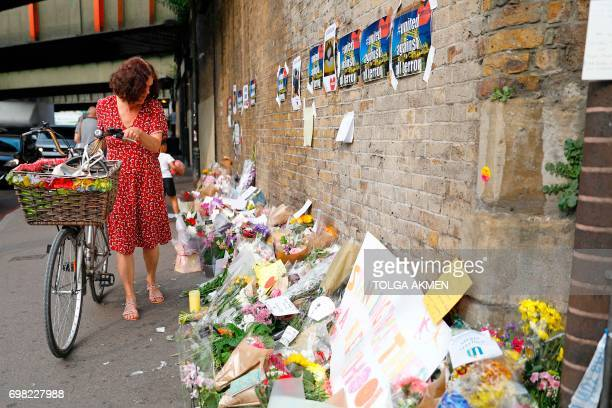 Flowers and tributes are pictured in the Finsbury Park area of north London on June 20 following a van attack on pedestrians on June 19 Ten people...