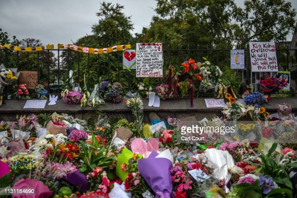 Flowers and tributes are placed around the wall of the Botanic Gardens on March 17 2019 in Christchurch New Zealand 50 people are confirmed dead with...