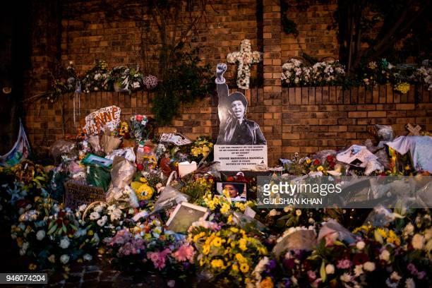 TOPSHOT Flowers and tributes are placed at a memorial outside the home of Winnie MadikizelaMandela prior to her funeral ceremony on April 14 2018...