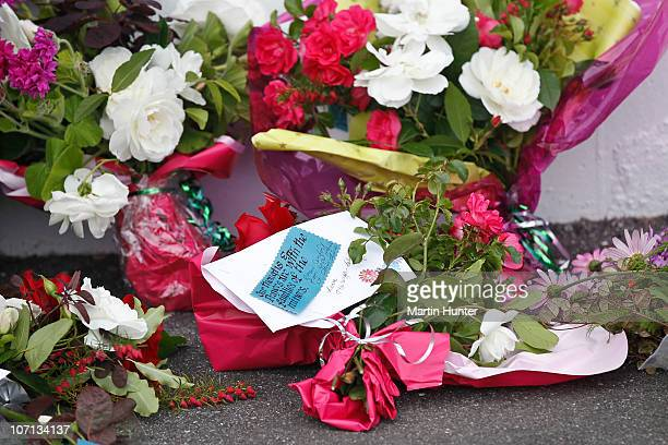Flowers and tributes are placed at the Grey District Council building on November 25 2010 in Greymouth New Zealand Families were informed there would...