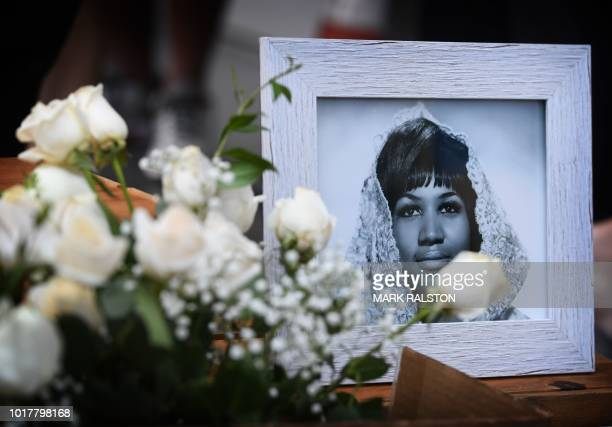 Flowers and tributes are placed on the Star for Aretha Franklin on the Hollywood Walk of Fame in Hollywood California August 16 after the music icon...