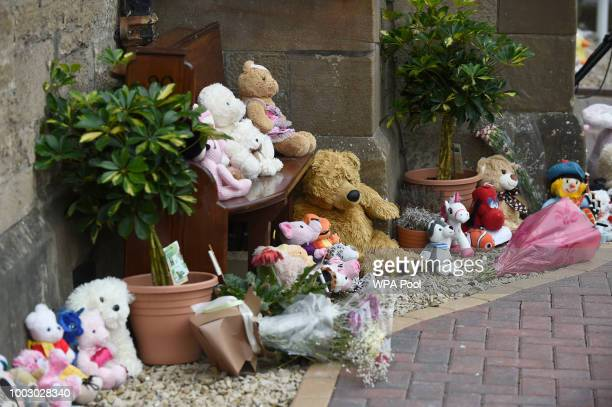 Flowers and tributes are seen at the funeral of sixyearold Alesha MacPhail at the Coats Funeral Home on July 21 2018 in Coatbridge Scotland Alesha...
