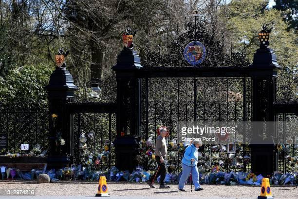 Flowers and tributes are seen outside The Norwich Gates at Sandringham House on April 17, 2021 in Sandringham, Norfolk. The Duke of Edinburgh...