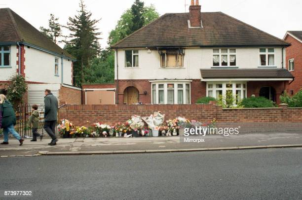 Flowers and tributes at the scene of an arson attack on Hemdean Road Caversham Sevenyearold Emily Salvini was killed in the fire 8th May 1997