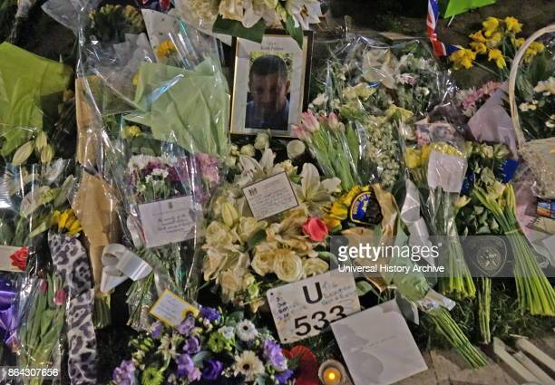 Flowers and tributes decorate a portrait of the murdered Police officer PC Keith Palmer at Parliament green opposite the British Parliament in London...