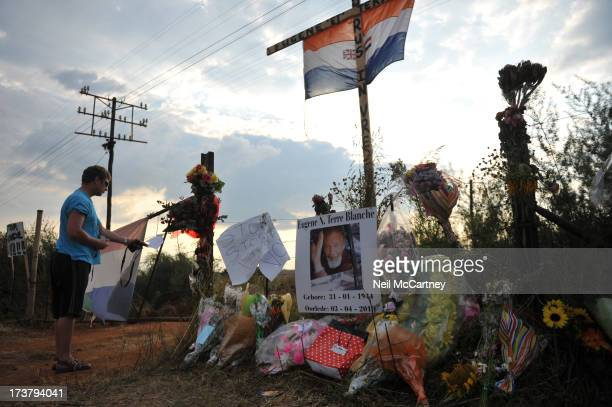 CONTENT] Flowers and tributes left at the gate of AWB founder Eugene Terreblanche's farm in Ventersdorp North West on the day of his funeral 8 April...