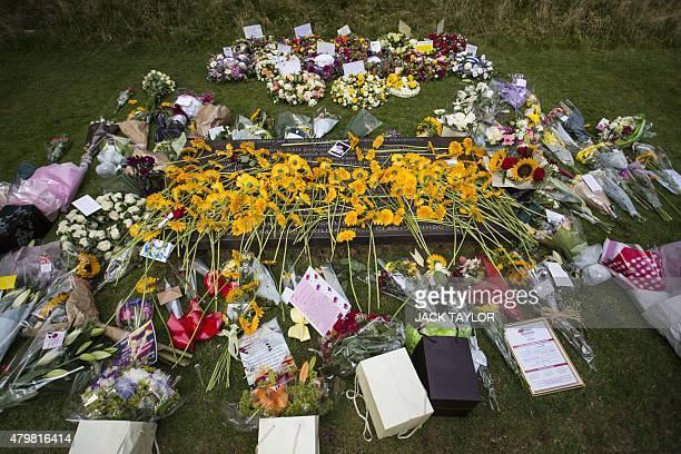 Flowers and tributes left by members of the public and survivors are placed by the 7/7 memorial in London's Hyde Park on July 7 in memory of the 52...