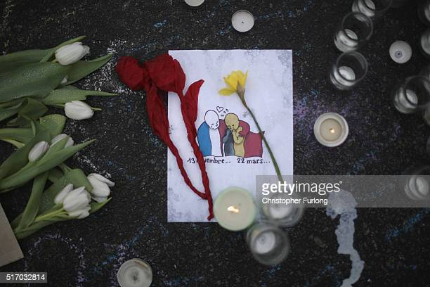 Flowers and tributes to the victims and injured continue to adorn the Place de la Bourse following yesterday's terrorists attacks on March 23 2016 in...