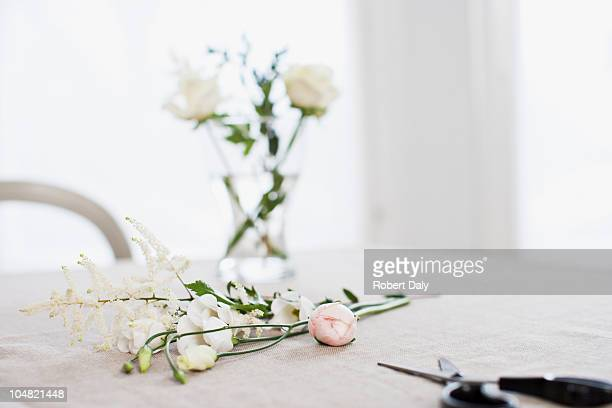 flowers and vase on table with scissors - arranging stock pictures, royalty-free photos & images