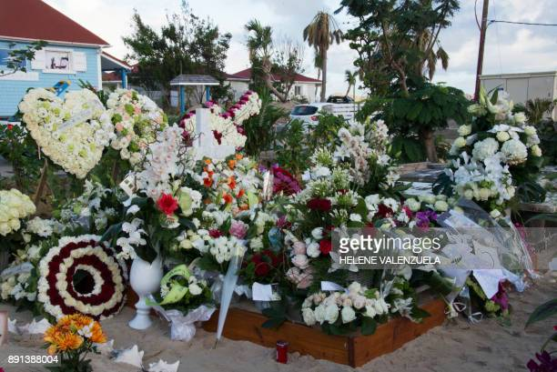 Flowers and wreaths are pictured on the tomb of late French music icon Johnny Hallyday on the French Caribbean island of SaintBarthelemy on December...