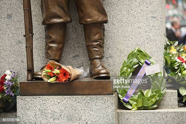 Flowers and wreaths are seen during the Remembrance Day Service held at the Cenotaph Martin Place on November 11 2016 in Sydney Australia This year...