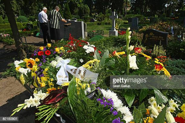 Flowers and wreaths lie on a cart as friends and relatives of Bernd K pay their last respects at his anonymous grave at his funeral on August 1 2008...