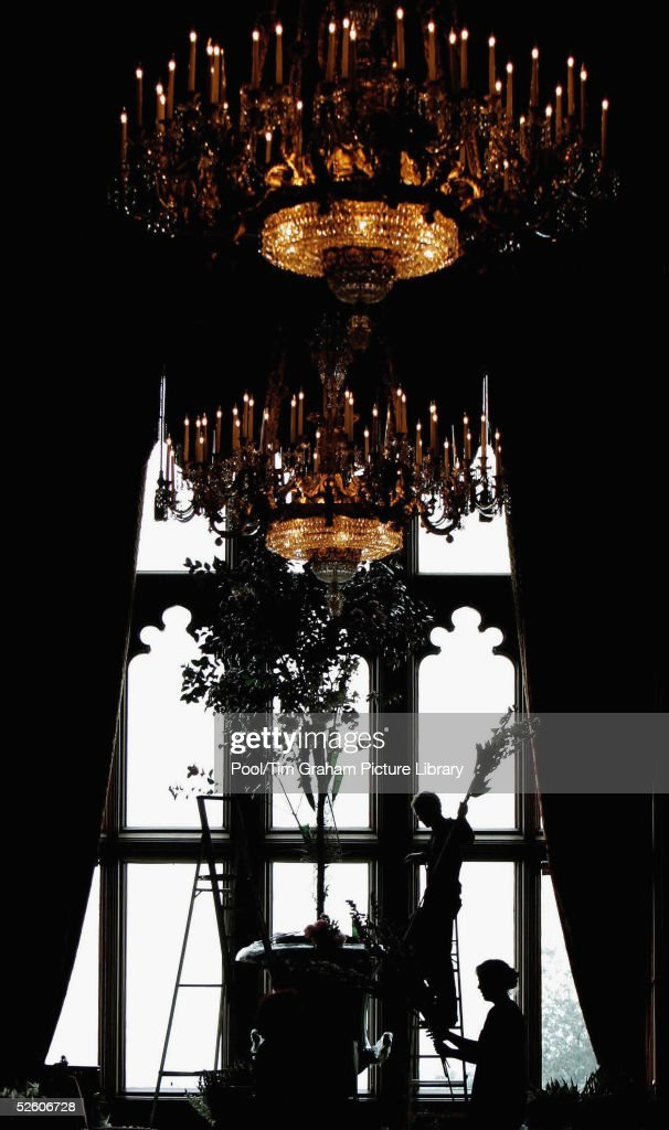Flowers are arranged below chandeliers in the Grand Reception Room in Windsor Castle as preparations are made for the reception after the royal wedding between Prince Charles and Camilla Parker Bowles in Windsor on April 8, 2005 in Windsor, England.