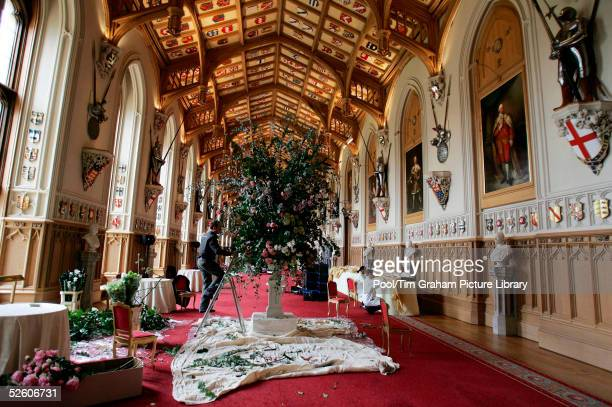 Flowers are arranged in St George's Hall in Windsor Castle as preparations are made for the reception after the royal wedding between Prince Charles...