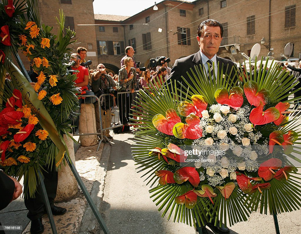 Duplicate luciano pavarotti funeral photos and images getty images flowers are carried through the streets of modena for the funeral of italian tenor luciano pavarotti izmirmasajfo