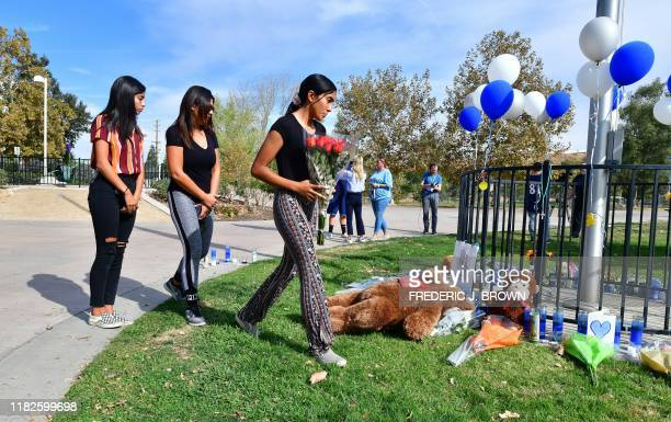 Flowers are delivered to a makeshift memorial in Central Park not far from Saugus High School on November 15 2019 in Santa Clarita California where...