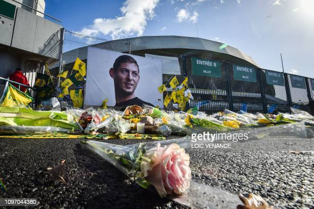 Flowers are displayed in front of the portrait of Argentinian forward Emiliano Sala at the Beaujoire stadium in Nantes, on February 10, 2019. - FC...