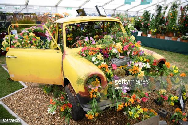 Flowers are displayed in the chassis of a mini car on the press preview day of the Hampton Court Palace Flower Show at Hampton Court Palace on July 3...
