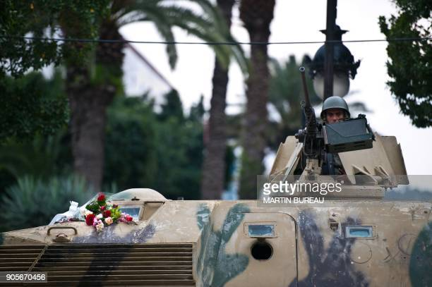 Flowers are displayed on a Tunisian army tank in Tunis on January 18 2011 Riot police fired tear gas and clashed with protesters on January 18 at a...