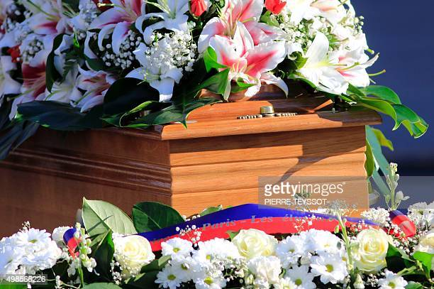 Flowers are displayed on the coffin of Valeria Solesin on Venice's San Marco Square on November 24 2015 during a funeral ceremony for italian victim...