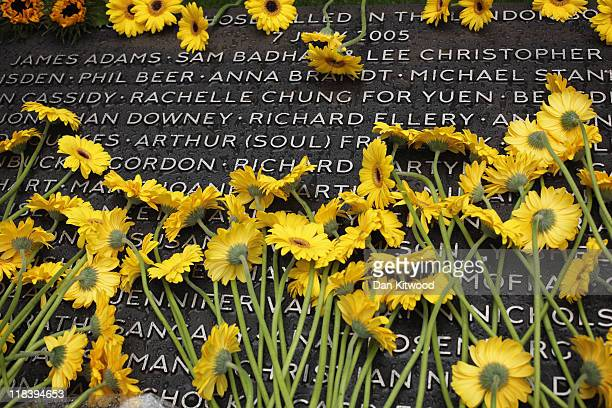 Flowers are laid after a service at the memorial to the victims of the July 7 2005 London bombings in Hyde Park on July 7 2011 in London England...