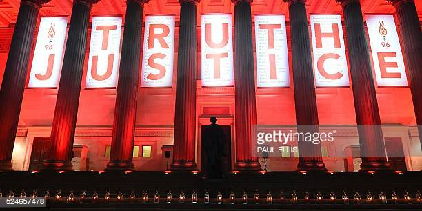 Flowers are laid and candles are lit on the steps of St Georges Hall in Liverpoolnorth west England on April 26 in remembrance of the 96 Liverpool...