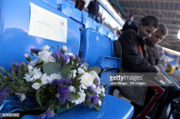 Flowers are laid at Madejski Stadium in Reading on the seat of Charlie Matthews who died last week during the train crash near Reading before the...