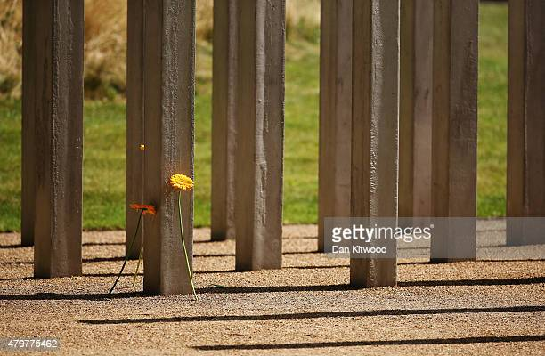 Flowers are laid at the 52 steel pillar memorial to the victims of the July 7 2005 London bombings in Hyde Park on July 7 2015 in London England...