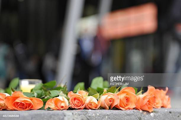 Flowers are laid at the front of the Melbourne Convention and Exhibition Centre to remember the lives of those lost onboard Malaysia Airlines flight...
